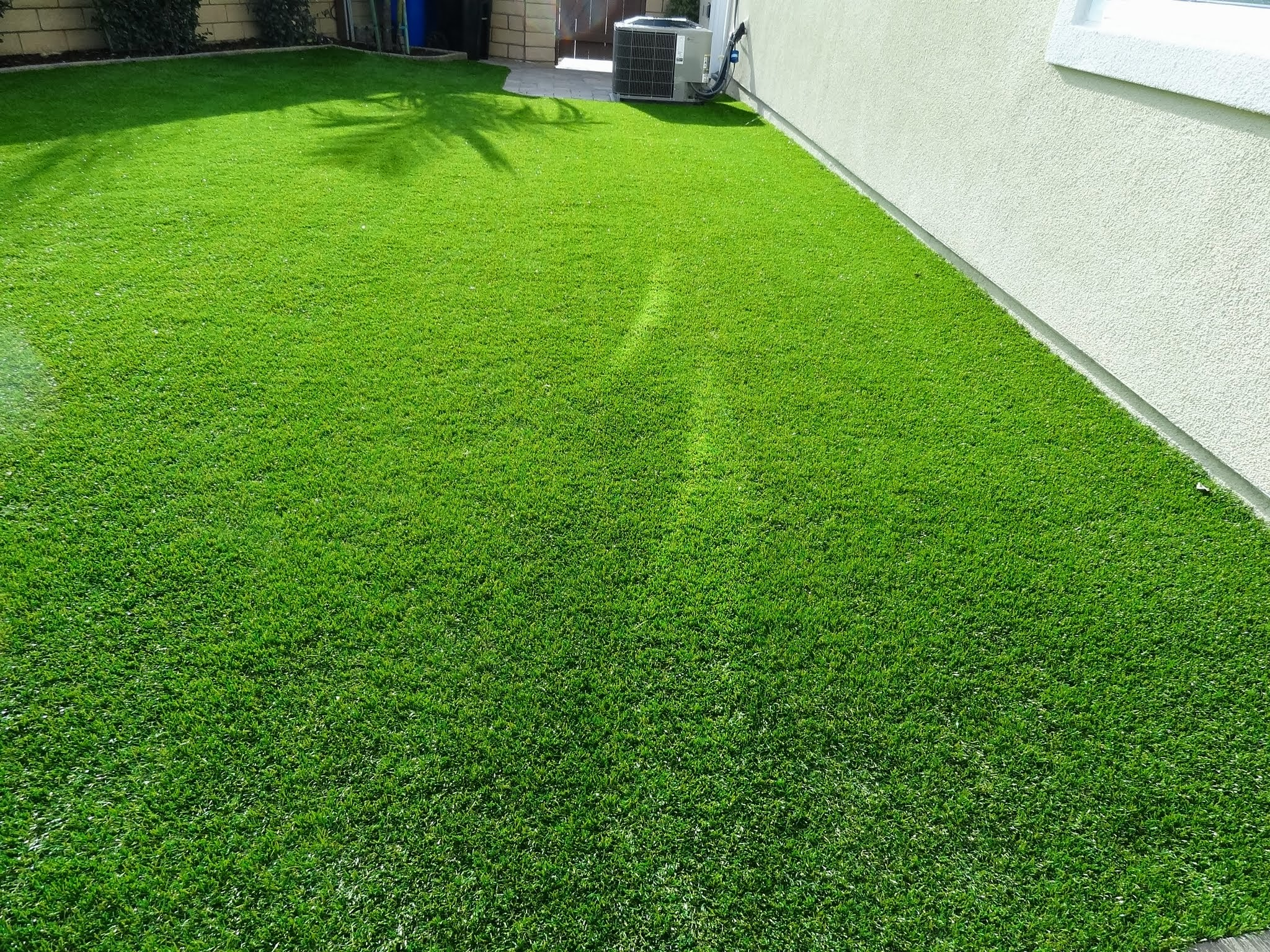 Energy-Efficient-Windows-Melting-Artificial-Grass